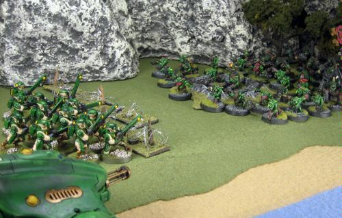 A unit of Firewarriors bravely faces a mob of Orks and Gretchin
